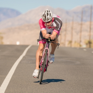 Andy Funk is leaning against fierce winds as he rides towards Twentynine Palms. His bike is tilted far to the left to force the bike to ride straight.