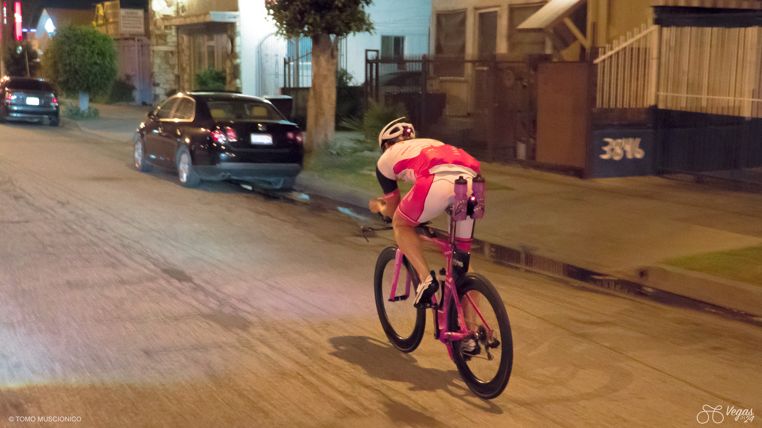 Less than an hour into Andy Funk's record setting ride, the homes and businesses along these Los Angeles neighborhoods are barricaded with bars and gates.