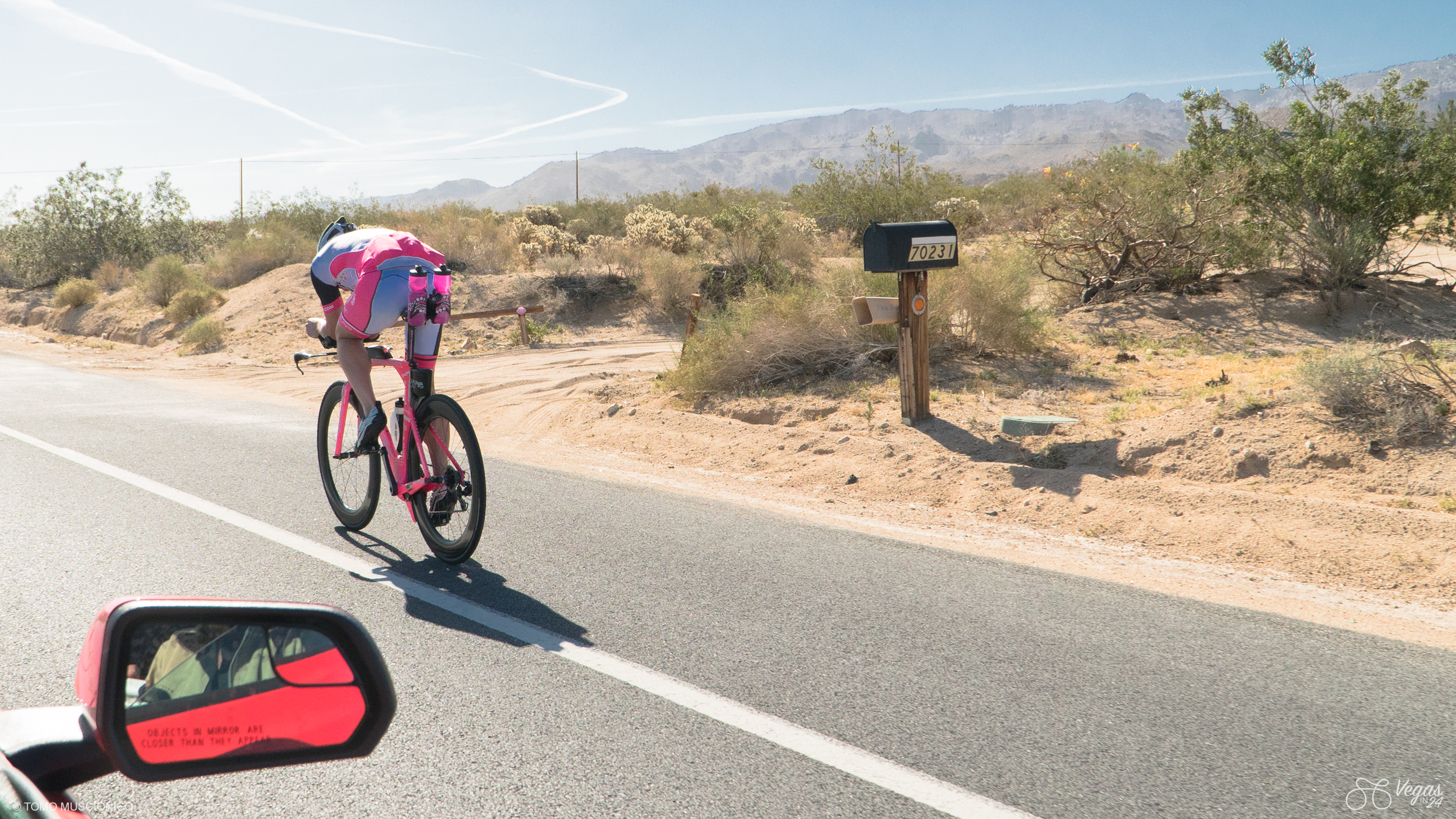 After a 20-mile long climb to Yucca Valley, Andy Funk is enjoying his descent. He is pedaling at race pace and you need a car in order to keep up.