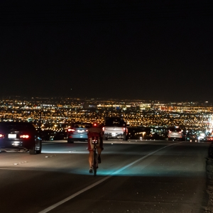 As Andy Funk crests the final hill after more than 20 hours of riding, Las Vegas appears below him. 18 miles remain until Andy will reach the finish line.
